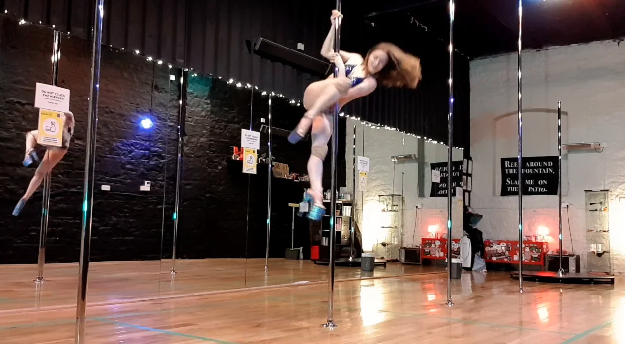 passe dismount pole dance spin