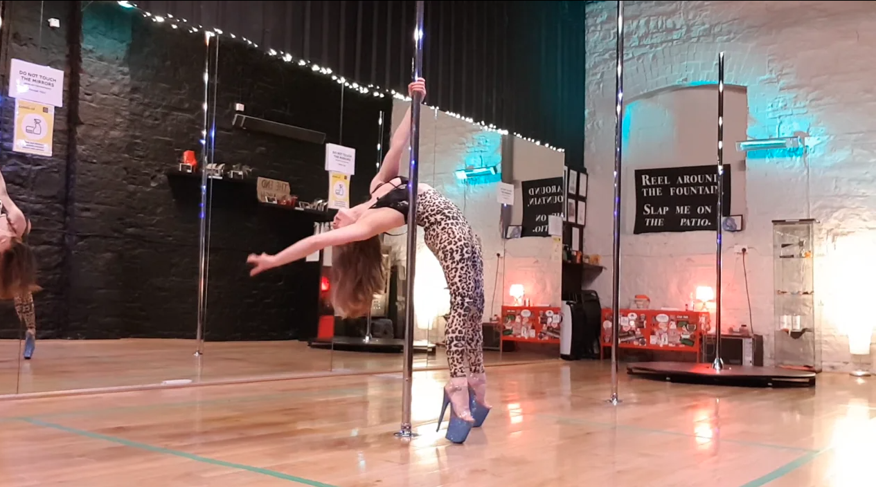 pole dance back arch descent