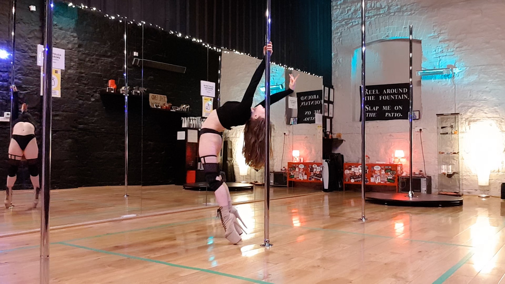 arlene doing a backbend with the pole