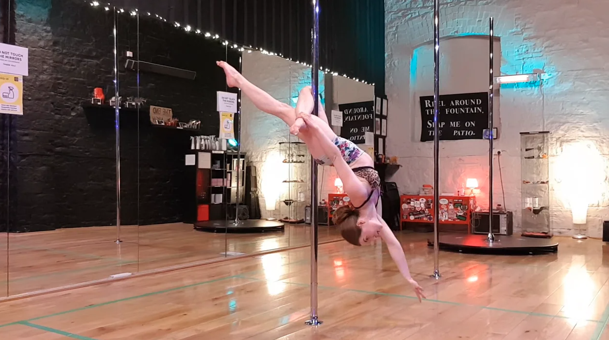 arlene doing a cross knee release with the pole