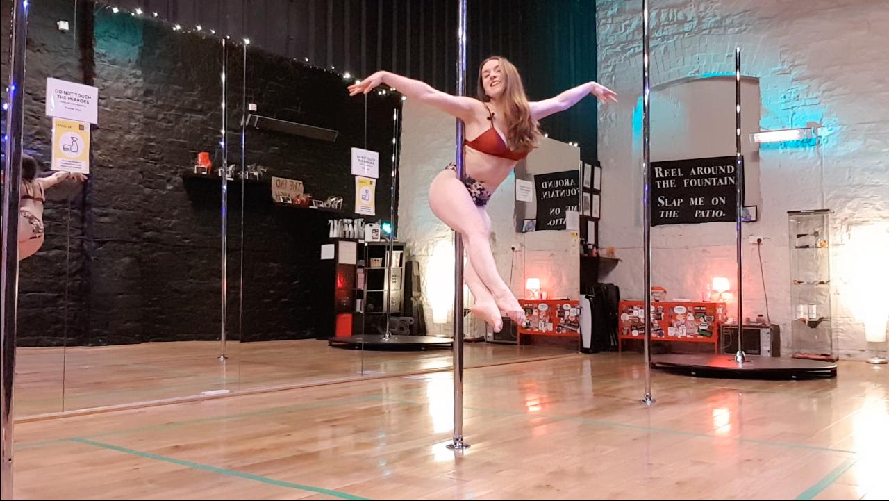 arlene demonstrating the angel pole trick