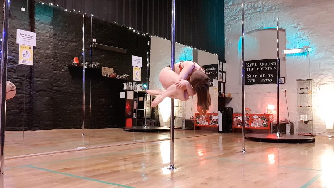 Arlene demonstrating sad girl pole on the pole